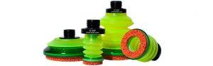 Cuatro ventosas color verde con espumas naranjas en los labios de la marca PIAB